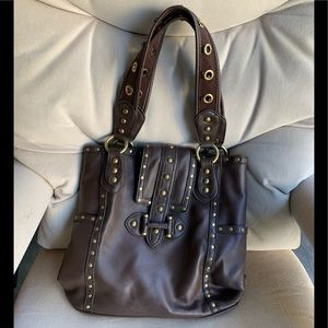 Brown purse with gold metal grommets